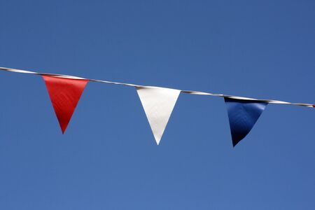 Close up of bunting hanging on Broadstairs seafront, Kent