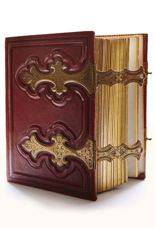 Old dark red antique book, with golden clasp and pages photo