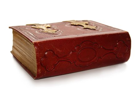 Closed red antique book ornate spine showing