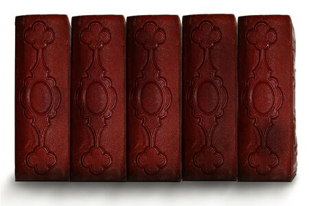 Old dark red antique book spines showing  photo