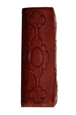 Spine of dark red antique book with ornate design pattern photo