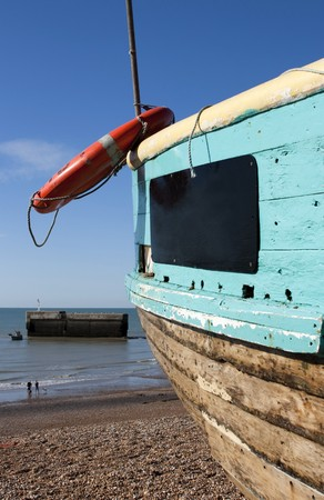 View of hastings beach with boat, England photo