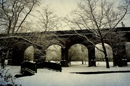 Early morning with snow covered London Underground bridge