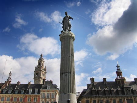 Statue of the French Revolution (built 1792) with the tower of the Chambre de Commerce in the distance