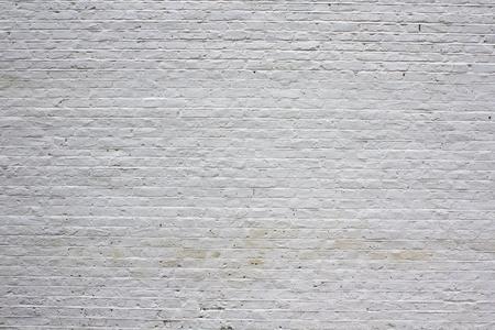 Brick wall painted white photo