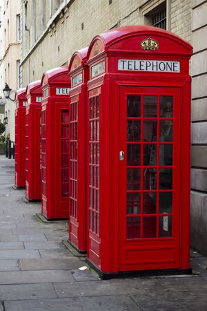 covent: Row of old style UK red phone boxes in Covent Garden, London Stock Photo