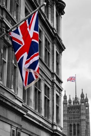 Union Jack with Houses of Parliament in distance, London, England