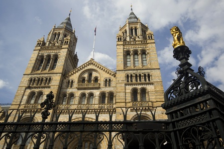 Golden lion statue on gates to Natural History Museum, London, England photo