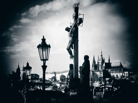 Silhouette of the Calvary Cross with Prague Castle in distance  Czech Republic