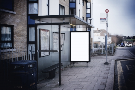 Blank sign at bus stop photo