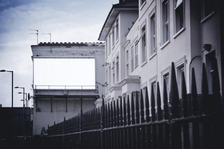 Blank billboard on side of building photo