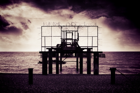 Front view of remains of West Pier on Brighton Beach, England UK photo