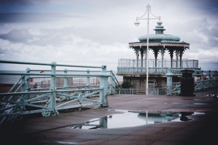 Pavilion reflected in puddle on a wet day in Brighton, England, UK photo