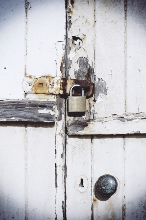 Rusty lock on wooden door photo