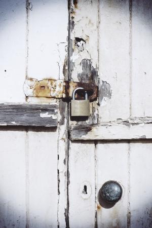 Rusty lock on wooden door Stock Photo - 18465786