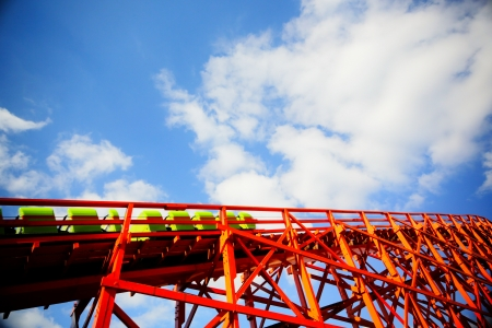 Roller coaster cabs going upwards on tracks