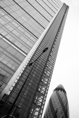 30 st mary axe: LONDON - SEPTEMBER 21  The modern glass buildings of the 30 St Mary Axe, Swiss Re, Gherkin alongside Heron Tower, September 21, 2013, during the annual Open House event in London, UK  Editorial