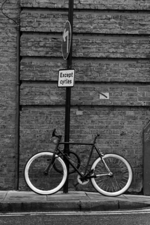 one lane road sign: Cycle tied to post, Old Street, City of London