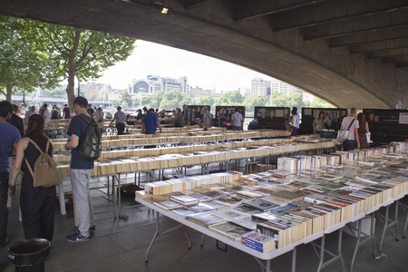 jumble: LONDON, UK - JUNE 21 2014: The Southbank Centres Book Market, London. Tucked under the Waterloo Bridge on Queens Walk.