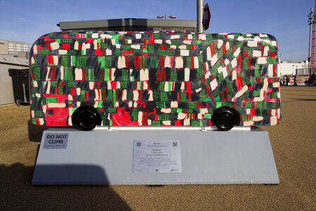 paralympic: LONDON - JANUARY 24. Year of the Bus exhibition with 60 decorative bus models, January 24, 2015; this one named Trammin located at Queen Elizabeth Olympic Park, London, UK. Editorial