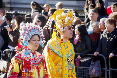 headress: LONDON - February 10. Parade heading from Trafalgar Square, during the Chinese New Year of the Rat, February 10, 2008, London, England UK