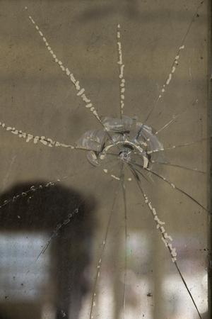 crazed: Broken Glass Window Stock Photo