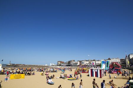 low prizes: MARGATE, UK-August 8: Visitors on Margate beach in Britain. Margates main sands have been awarded a blue flag for high standards. August 8, 2015 Margate, Kent UK Editorial