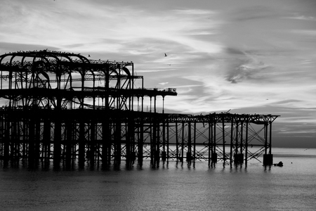 brighton: Remains of Brighton Pier left standing in sea at sunset, Brighton West Pier, England, UK Stock Photo