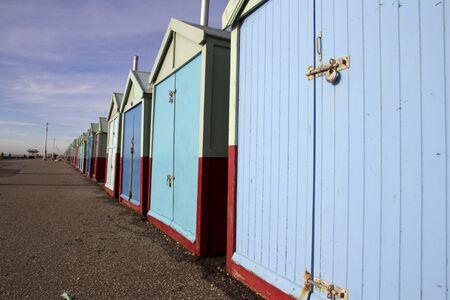 beachfront: Long row of beach huts on Brighton seafront, Brighton, England, UK