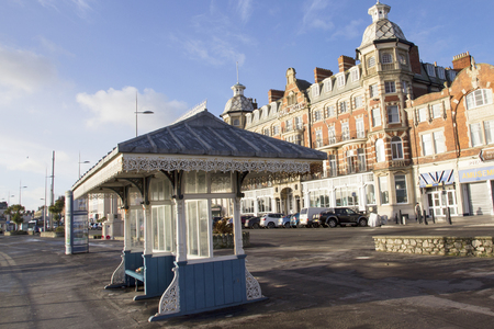 WEYMOUTH, DORSET, UK - DECEMBER 26, 2017. View of the Victorian Royal Hotel along the Esplanade promenade with a shelter in the foreground, Weymouth, Dorset, England, UK, December 26, 2017. 에디토리얼