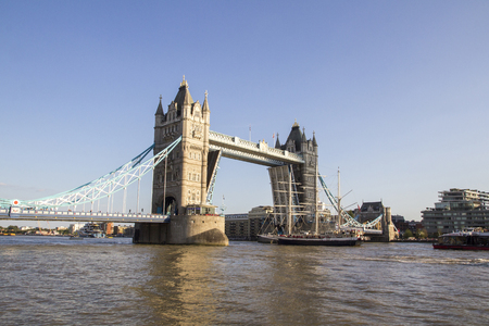 LONDON, UK - SEPTEMBER 1, 2018. View of Tower Bridge on the River Thames opening for the Lord Nelson tall ship. London, England, UK, September 1, 2018 Reklamní fotografie - 115890505