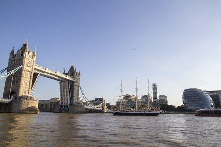LONDON, UK - SEPTEMBER 1, 2018. View of Tower Bridge on the River Thames opening for the Lord Nelson tall ship. London, England, UK, September 1, 2018