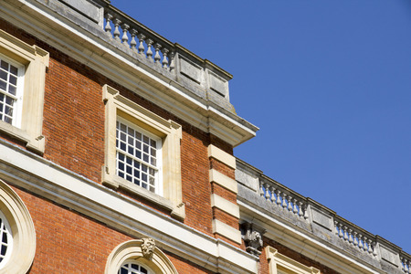 LONDON, UK - May 11, 2018. Square window at Hampton Court Palace which was originally built for Cardinal Thomas Wolsey 1515, later became King Henry VIII residence. London, Uk - May 11, 2018