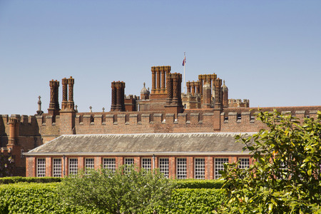 LONDON, UK - May 11, 2018. Rooftops of Hampton Court Palace which was originally built for Cardinal Thomas Wolsey 1515, later became King Henry VIII residence. London, Uk - May 11, 2018