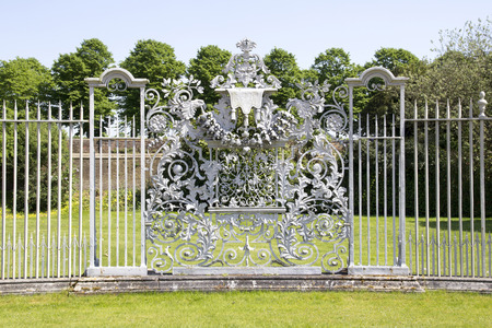LONDON, UK - May 11, 2018. Gate detail at Hampton Court Palace which was originally built for Cardinal Thomas Wolsey 1515, later became King Henry VIII residence. London, Uk - May 11, 2018