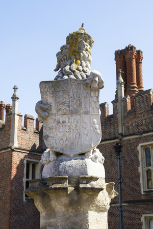 LONDON, UK - May 11, 2018. Stone sculptures at Hampton Court Palace which was originally built for Cardinal Thomas Wolsey 1515, later became King Henry VIII residence. London, Uk - May 11, 2018