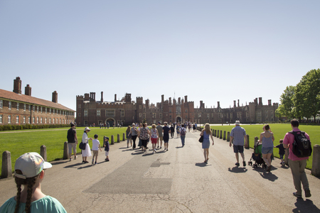 LONDON, UK - May 11, 2018. Walkway to Hampton Court Palace which was originally built for Cardinal Thomas Wolsey 1515, later became King Henry VIII residence. London, Uk - May 11, 2018 Redakční