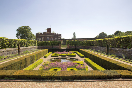 LONDON, UK - May 11, 2018. Gardens at Hampton Court Palace which was originally built for Cardinal Thomas Wolsey 1515, later became King Henry VIII residence. London, Uk - May 11, 2018
