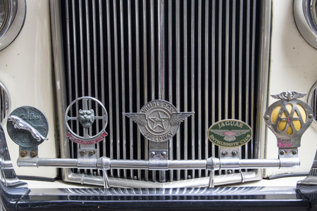 LONDON, ENGLAND - April 28, 2018. Badges at the annual Classic Car Exhibition and Vintage Clothing Market at Kings Cross, London, England, April 28, 2018.