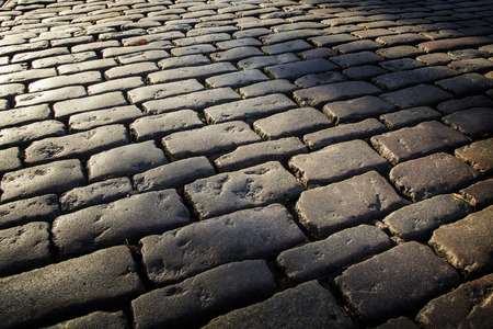 Cobblestone background with long shadows at sunset, London Banque d'images - 120307947