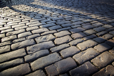 Cobblestone background with long shadows at sunset, London Banque d'images - 120307950