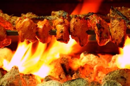 chicken kebab: chicken tikka over bbq Stock Photo