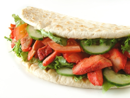 turkish kebab: chicken tikka wrapped in naan bread