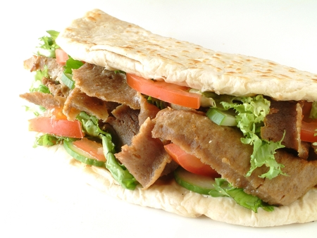 turkish kebab: Lamb donner kebab wrapped in naan bread Stock Photo