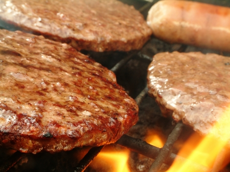 burgers cooking on barbecue