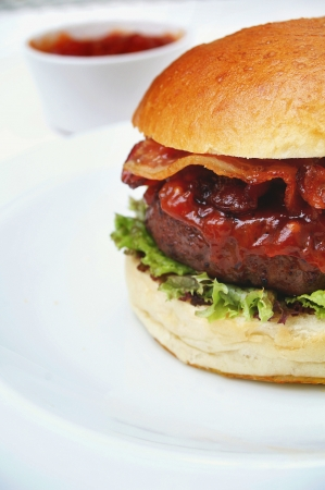 burger on bun with bacon