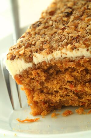 traditional carrot cake with butter cream and walnut photo