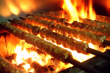 turkish kebab: shish Kofte kebab on flaming barbecue