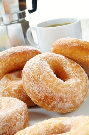 sugared donuts with coffee Stock Photo
