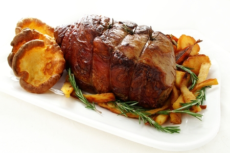 traditional roast beef joint with vegetables